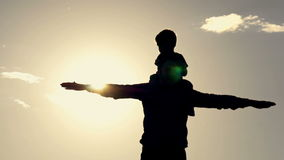 Dad and son show the flight with their hands. stock video footage