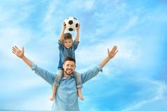 Dad and son with soccer ball. Outdoors Royalty Free Stock Images