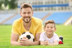 Dad and son with soccer ball. In stadium Royalty Free Stock Images