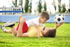 Dad and son with soccer ball. In stadium royalty free stock image
