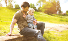 Dad and son in summer day Stock Photos