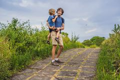 Dad and son tourists in Campuhan Ridge Walk , Scenic Green Valley in Ubud Bali. Traveling with children concept.  stock photo