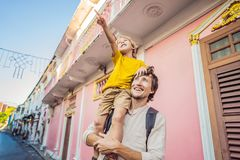 Dad and son tourists on the Street in the Portugese style Romani in Phuket Town. Also called Chinatown or the old town royalty free stock photography