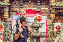 Dad and son are tourists on the Street in the Portugese style Romani in Phuket Town. Also called Chinatown or the old royalty free stock photos