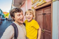 Dad and son tourists on the Street in the Portugese style Romani in Phuket Town. Also called Chinatown or the old town royalty free stock photos