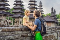 Dad and son tourists in Traditional balinese hindu Temple Taman. Ayun in Mengwi. Bali, Indonesia. Traveling with children concept royalty free stock photos