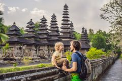 Dad and son tourists in Traditional balinese hindu Temple Taman. Ayun in Mengwi. Bali, Indonesia. Traveling with children concept royalty free stock photography