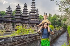Dad and son tourists in Traditional balinese hindu Temple Taman. Ayun in Mengwi. Bali, Indonesia. Traveling with children concept royalty free stock images