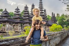 Dad and son tourists in Traditional balinese hindu Temple Taman. Ayun in Mengwi. Bali, Indonesia. Traveling with children concept stock images