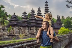 Dad and son tourists in Traditional balinese hindu Temple Taman. Ayun in Mengwi. Bali, Indonesia. Traveling with children concept stock photography