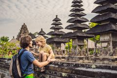 Dad and son tourists in Traditional balinese hindu Temple Taman royalty free stock image