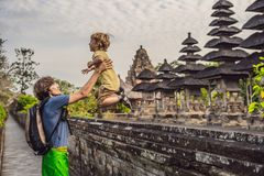 Dad and son tourists in Traditional balinese hindu Temple Taman stock photography