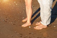 Dad and son walk on the beach barefoot stock photography
