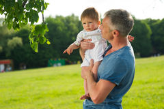 Dad and son on a walk. Stock Images