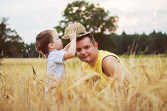 Dad with son walking in a field Royalty Free Stock Photos