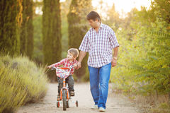 Dad and son walking in the park in summer Stock Photo