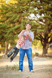 Dad and son walking in the park in summer Stock Photos