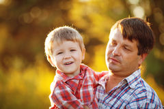 Dad and son walking in the park in summer Stock Images