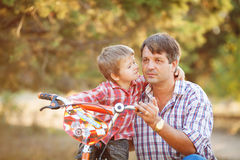 Dad and son walking in the park in summer Stock Image