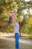 Dad and son walking in the park in summer Stock Photography