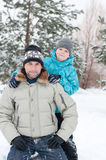 Dad and son walking in  winter park Royalty Free Stock Image