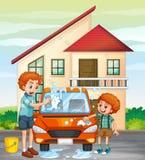 Dad and son washing car at home Royalty Free Stock Photography