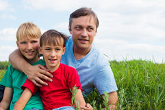 Dad with sons at field Royalty Free Stock Photo