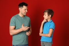 Dad talking with his son royalty free stock photos