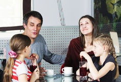 Dad talking to daughter. While family sitting at cafe table Stock Photos