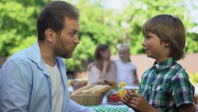 Dad talking to son while mom having conversation with daughter, trust relations. Stock footage stock video footage