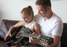Dad teaches daughter. Royalty Free Stock Photography