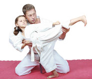 Dad teaches his daughter dressed in a kimono  punch kicking Royalty Free Stock Images