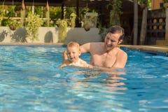 Dad teaches his son to swim Royalty Free Stock Image