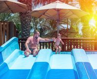 Dad teaches a little daughter to swim royalty free stock image