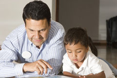 Dad teaching son Royalty Free Stock Photo