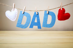 DAD text and felt hearts hanging on a string Royalty Free Stock Image