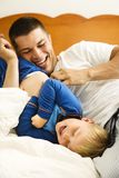 Dad tickling child. royalty free stock photo