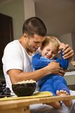 Dad tickling son. stock photography
