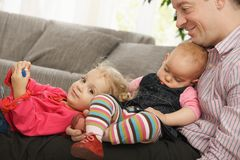 Dad with two daughters Stock Photography