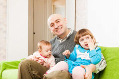 Dad and two daughters Stock Photography