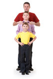 Dad and two sons. Are in a row on a white background Stock Photography