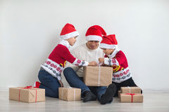 Dad with two sons. Happy family preparing for the New Year and Christmas holidays. Dad with two sons Royalty Free Stock Image