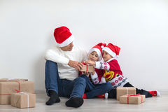 Dad with two sons. Happy family preparing for the New Year and Christmas holidays. Dad with two sons Stock Photos