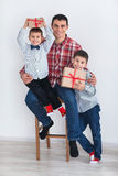 Dad with two sons. Happy family preparing for the New Year and Christmas holidays. Dad with two sons Stock Photography
