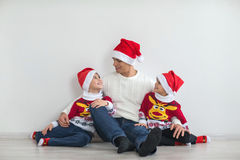 Dad with two sons. Happy family preparing for the New Year and Christmas holidays. Dad with two sons Stock Photo