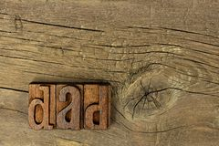 DAD vintage wood letters on a rustic wood background Royalty Free Stock Image