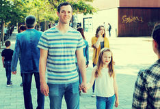 Dad walking by the hand with smiling girl Stock Images