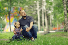 Dad walks with his daughter in  park Royalty Free Stock Photo