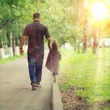 Dad walks with his daughter in  park Royalty Free Stock Photography