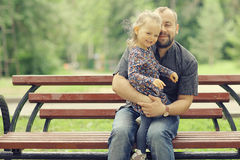 Dad walks with his daughter in  park Royalty Free Stock Images